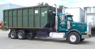 roll-off-container-on-truck-midwest-sanitation-and-recycling